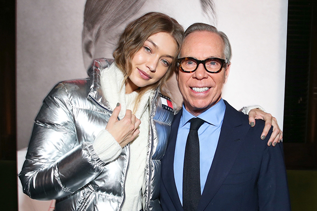 Gigi Hadid with Tommy Hilfiger at his book launch in New York this year.