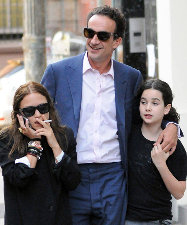 Olsen with husband Sarkozy and his daughter (right)