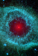 "Comets Kick up Dust in Helix Nebula: ""This infrared image from NASA Spitzer Space Telescope shows the Helix nebula, a cosmic starlet often photographed by amateur astronomers for its vivid colors and eerie resemblance to a giant eye."""