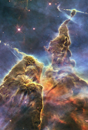 "Hubble Captures View of Mystic Mountain: ""NASA Hubble Space Telescope captures the chaotic activity atop a three-light-year-tall pillar of gas and dust that is being eaten away by the brilliant light from nearby bright stars in a tempestuous stellar nursery called the Carina Nebula."""