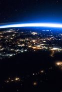 "International Space Station: ""The International Space Station continues its orbit around the Earth as Expedition 50 astronauts captured this night image of sparkling cities and a sliver of daylight framing the northern hemisphere."""