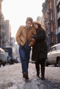 "Artist Suze Rotolo has been credited with influencing Bob Dylan's political stance and featured on the cover of his 1963 album ""The Freewheelin' Bob Dylan""."