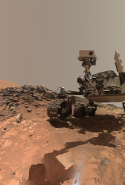 "Looking Up at Mars Rover Curiosity in Buckskin Selfie: ""This low-angle self-portrait of NASA's Curiosity Mars rover shows the vehicle at the site from which it reached down to drill into a rock target called ""Buckskin"" on lower Mount Sharp. The selfie combines several component images taken by Curiosity's Mars Hand Lens Imager (MAHLI) on Aug. 5, 2015, during the 1,065th Martian day, or sol, of the rover's work on Mars."""