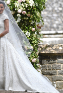 "4.	The bride wore custom-made Giles Deacon that featured bespoke lace. ""I wanted that 'how-was-that-done?' factor,"" Deacon told Business of Fashion. ""It's all hand-pieced which is why you don't actually see a seam."" Deacon also said of his client: ""She has a great eye, she knew what SHE wanted."""