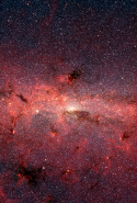 "A Cauldron of Stars at the Galaxy Centre: ""This dazzling infrared image from NASA Spitzer Space Telescope shows hundreds of thousands of stars crowded into the swirling core of our spiral Milky Way galaxy."""