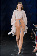 The designer also extended the volume to oversized sleeves, which were paired with paper-bag waist trousers.