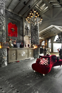 """The Hôtel Le K2 Palace forms a veritable hamlet, made up of a main building and its adjoining chalets, nestled into the mountainside, integrating seamlessly into the landscape. The K2 Palace benefits from a privileged location, being both near the center of Courchevel 1850; yet, still retaining a high level of privacy and having ski-in ski-out access. The hotel and suite-chalets spread along the slope and overlook the valley for panoramic views. Decorated as unique worlds with precious materials, the rooms mix the charm of elegant authenticity with high tech modern equipment. The suite-chalets of the K2 Palace combine the intimacy of a private residence with the ultimate in service provided by the devoted staff of the hotel. Jean-Rémi Caillon and his team invite you to enjoy a festival of flavors at the gastronomic restaurant Le Kintessence, awarded with two-Michelin star. At the Black Pyramid you may discover modern and inventive cuisine. Connoisseurs of spirits and cigars will appreciate the elegant Winston Klub."""