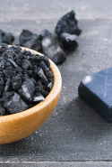 Activated charcoal. Used for its ability to bind to toxins and chemicals, allowing them to be flushed out of the body without being reabsorbed.