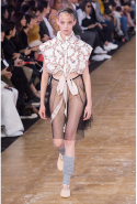 Furthering the disco-dance theme, the collection was paired with grey legwarmers and traditional nude ballet flats.