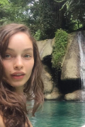 Brazlian model Luma Grothe marvels at mother nature by a waterfall in Jamaica / @thelumagrothe