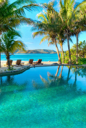 Necker Island, British Virgin Islands: This pricey paradise is owned by Sir Richard Branson, so his high-profile friends frequent, including Oprah, Steven Spielberg, Michael Douglas and Harry Styles. An individual island villa costs a tidy $27K/wk.