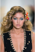 2. The curls! Has mussed-up French girl hair left the building? Gigi Hadid, Kendall Jenner and co were barely recognisable with big, bouncy, hot-rollers-required curls. If you prefer a less girly vibe, look to the tizzy masses at Proenza Schouler.