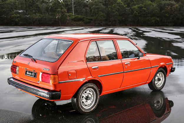 1980 MAZDA3: In the middle of the Mt Cotton track, a mob of kangaroos watch on as you do laps – They're cute, but they also drum up anxiety that at any moment they can jump out at you, especially when you're behind the wheel of a lightweight box void of modern day safety features. I've been told they're aware of the cars (Porsche hosts it's driving school here), but still, going from the brand new Mazda3 I drove up here (complete with airbags, ABS, Emergency Brake Assist, Driver Attention Alert and more), to this 48kW, 1.4L bean with slightly wobbly steering, on a very wet road, offered more of a thrill than one would expect.