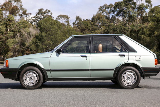 1984 MAZDA3 DELUXE: With a fabulous (deluxe?) colour palette of mint and mocha, a cassette tape deck and plush, foamy velvet (or is it chenille?) seats and a huge leisure-y boot: 1984's 323 is looking quite cool. As expected, the gearbox (5-speeds transmission? luxe) was still a little dinky, but now we're rocking a  front-wheel drive, 1.5L engine and a fancy '80s tachometer on the dash.