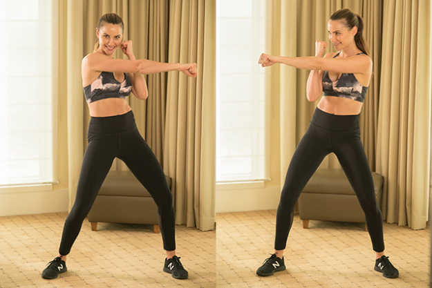"Move 2: Twist & punch combo. ""Time to work the upper body. Legs hip width apart, fists up, punch each hand to the alternate side, so left hand to right side, and so on. Really twist your torso, punch out strong. Keep those knees bent so you're sitting low and also activating your legs."""