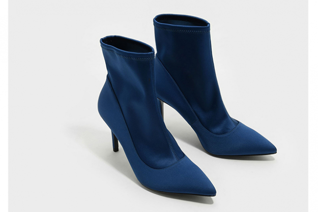 "7.	 Thanks to Balenciaga, the sock-boot trend shows no signs of abating. Make a splash in these navy ones, $79<p><a href=""https://goo.gl/GmfAKG"" target=""_blank"">Ankle Boot Stilettos&nbsp;</a></p>"