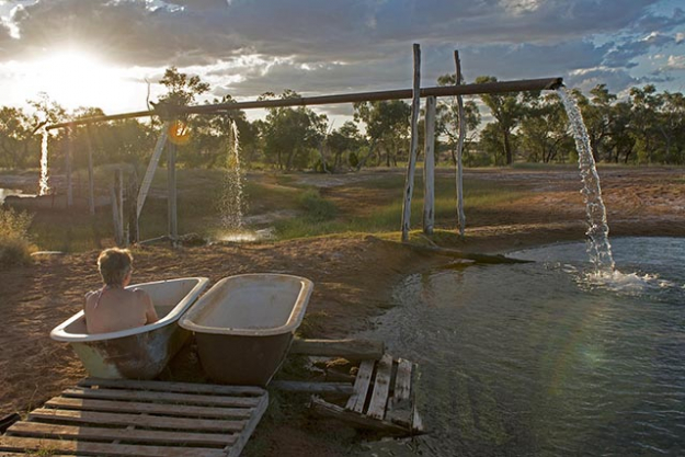 'Charlotte Plains Hot Spring', Cunnamulla, Queensland: Located on an authentic outback sheep and cattle station, one of the property's main attractions is the 1890's station bore which pours thousands of gallons of hot mineral-laden water straight from the Great Artesian Basin; hundreds of metres below the earth's surface. You can luxuriate in the picturesque natural artesian bore pond or one of the cast iron baths filled with the therapeutic liquid. Others prefer to partake in a mineral-mud spa down one of the bore-drains where the water is a little cooler.