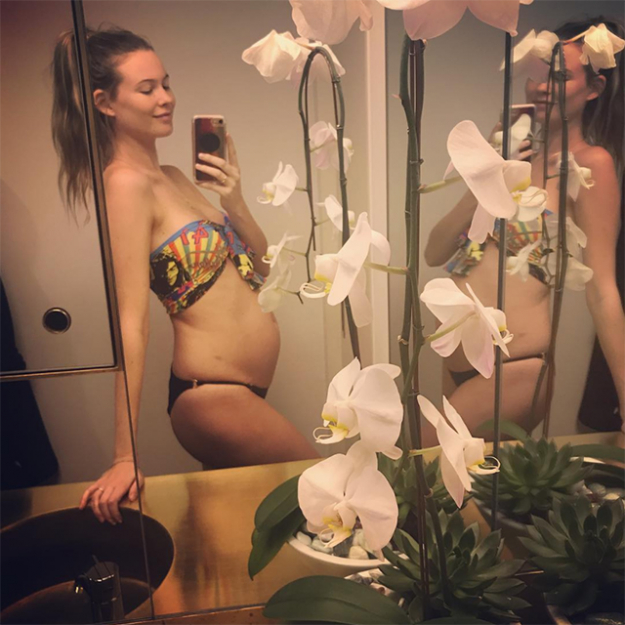 "Behati Prinsloo: Following the birth of her first child, Dusty Rose with Adam Levine last year, the Victoria's Secret Angel announced her second pregnancy, posting this photo to Instagram with the caption; ""ROUND 2."""