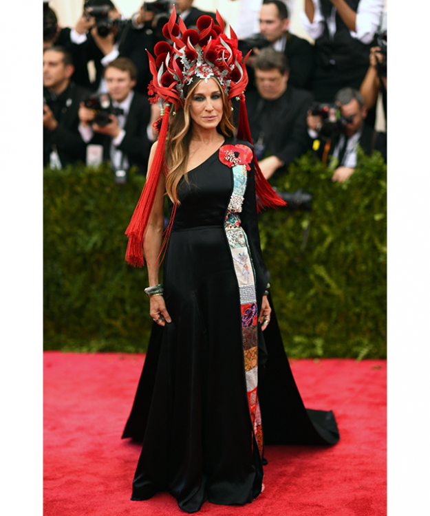 Even Sarah Jessica Parker looks frightened by her hat/DIY craft project at the Met Gala. It's easily replicated with just a few red ribbons, pompoms and tassels from your local Chinese restaurant.
