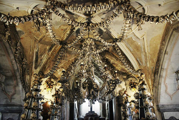 Sedlec Ossuary, Czech Republic. It doesn't get much more macabre than this chapel decked out with over 40,000 human skeletons, from a huge chandelier, candelabras and other decorations all constructed from bones.