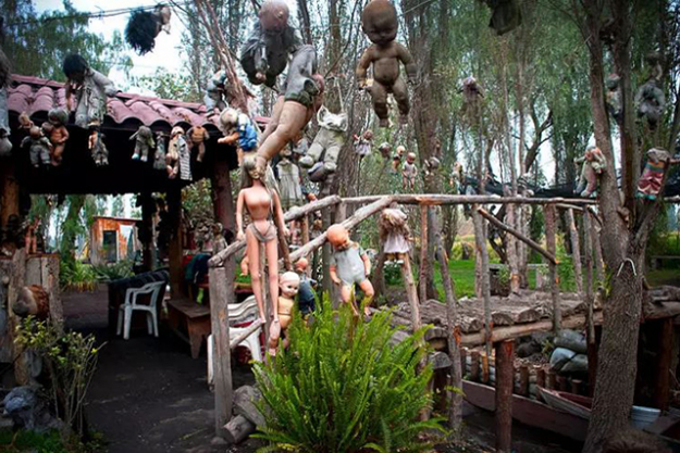 The Island of the Dolls, Mexico. A boat trip to Isla de las Munecas is only for the brave – hundreds of old dolls are strewn across the grounds, left by late owner Julian Santa Barrera, who believed they would ward off evil spirits.
