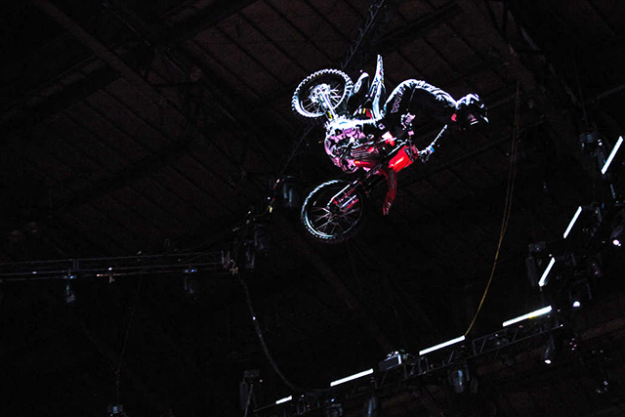 A motocross rider flies through the air at the show. Image: Getty