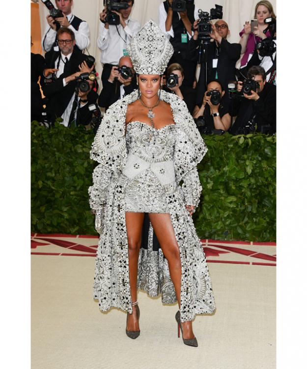 Co-host of the Met Gala, Rihanna, went all out in a pope-inspired look from Maison Margiela. Image credit: Getty Images.