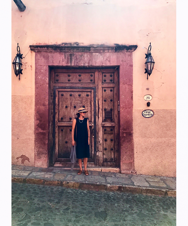 Pretty pink wall and amazing wooden door - love the San Miguel colours and textures.