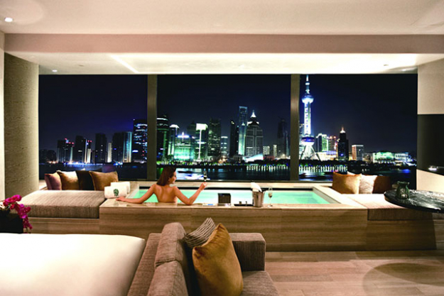 "For a serious dose of sky high living, the Banyan Tree's suites look straight down on the Bund and Huangpu River beyond. A big day exploring the city is best ended with a soak in your bathtub, looking out onto the city below.<p><a target=""_blank"" href=""https://www.expedia.com.au/Shanghai-Hotels-Banyan-Tree-Shanghai-On-The-Bund.h5437561.Hotel-Information"">Banyan Tree Shanghai on the Bund</a><br />Shanghai, China&nbsp;</p>"