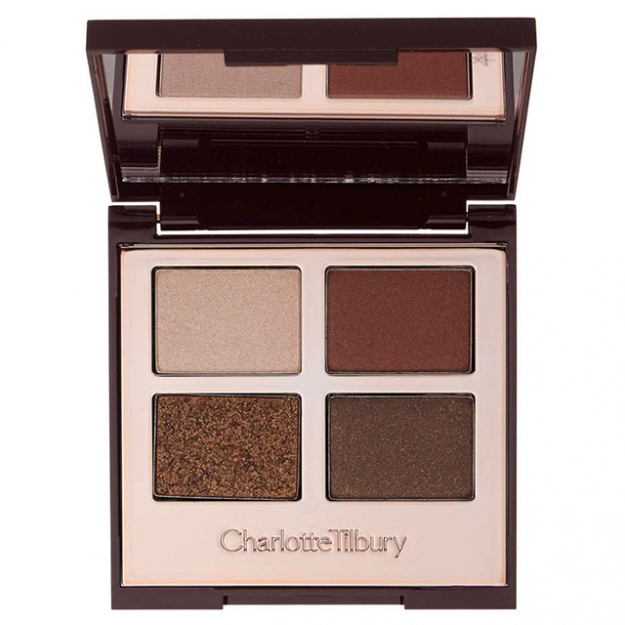 "Eyeshadow: ""Usually I'll grab this Charlotte Tilbury Luxury Eye Palette in Dolce Vita, which I'm in love with. I use the rosy highlighter shade on the lid and then I do the red all around, and I blend in the crease with a Charlotte Tilbury blending brush.""<p><a href=""http://www.charlottetilbury.com/au/luxury-palette-the-dolce-vita.html"">charlottetilbury.com/au</a></p>"
