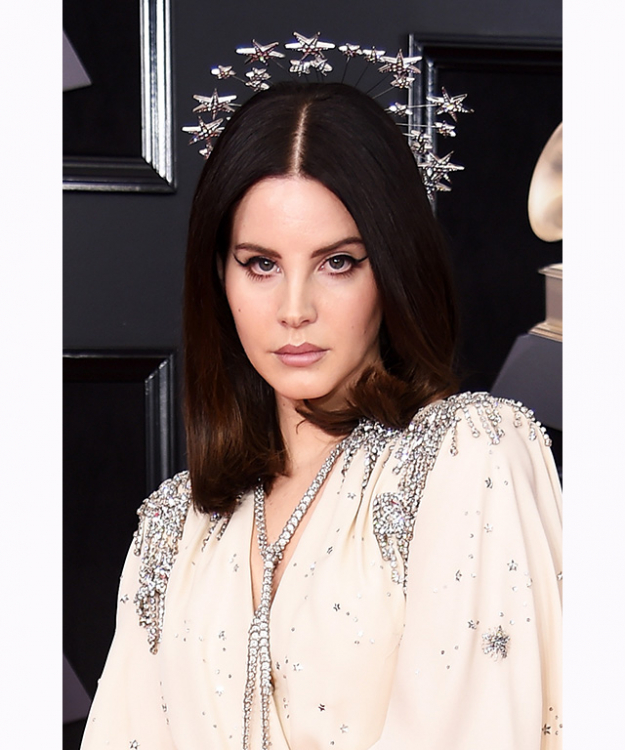 Lana Del Rey's trademark winged-eye and star headpiece