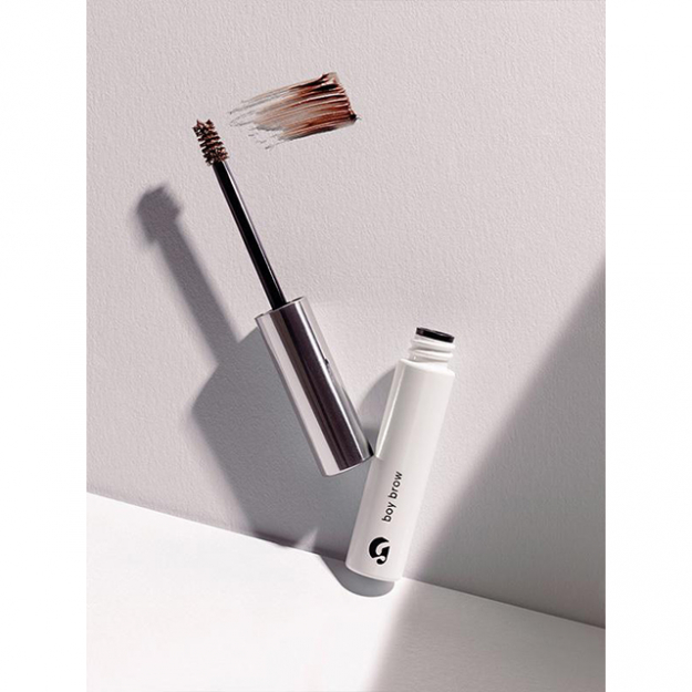 "Brows: ""I brush them up with either Glossier Boy Brow or this Eyeko Brow Gel. It makes a really bushy brow—the brush really fans everything out in a way that I love. If I need to fill in any spots I use Marc Jacobs Brow Wow Defining Pencil in Ash Brown.""<p><a href=""https://www.glossier.com/products/boy-brow"">glossier.com</a></p>"