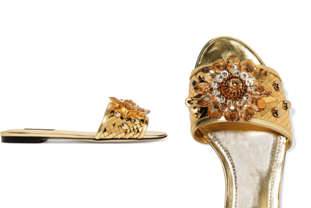 "Dolce & Gabbana crystal-embellished slides, $992 at Net-a-Porter.com<p><a target=""_blank"" href=""https://www.net-a-porter.com/nz/en/product/791102/Dolce_and_Gabbana/crystal-embellished-metallic-leather-slides"">Shop</a></p>"