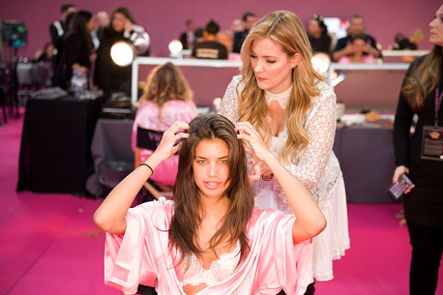 "Step 1. ""In order to get the sexy ""lived-in"" Victoria's Secret wave, it's important to have structure when you're curling. Start by bringing all of the hair forward, then divide it into clean, even sections using the Darby Clips. Select the temperature that is right for your hair."""