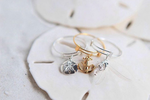 From left: Sand Dollar Expandable sterling silver ring, Anchor 14k gold-plated silver ring, Seahorse sterling silver ring, $69 each