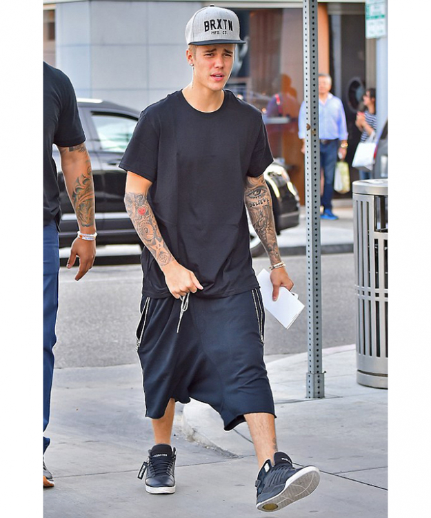 Biebs offers inspiration for the boys: throw on some baggy shorts (skort?), a dress-sized tee, slap on a baseball cap, add some fake tatts and you're done.