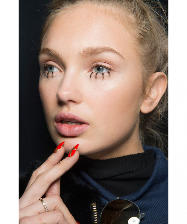 Unusual eye accents: From mannequin-esque bottom lashes with gold teardrops, to Dion Lee's dishevelled eye shadow, there were certainly no signs of a conventional smokey-eye backstage.