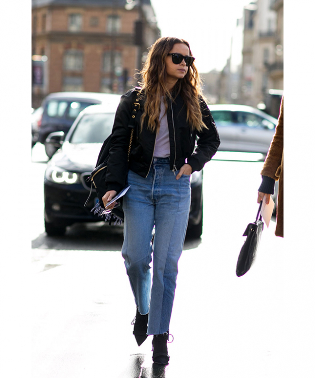 Miroslava Duma wearing Vetements jeans at Paris Fashion Week