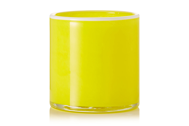 Housed in an arresting glass vessel, and scented with a bracing blend of white grapefruit, light musk and fern leaves, this candle makes a sunny addition to any room. It features a vegan soy-based wax and cotton wick for a clean, non-toxic burn. Lafco, white grapefruit scented candle, $65, net-a-porter.com