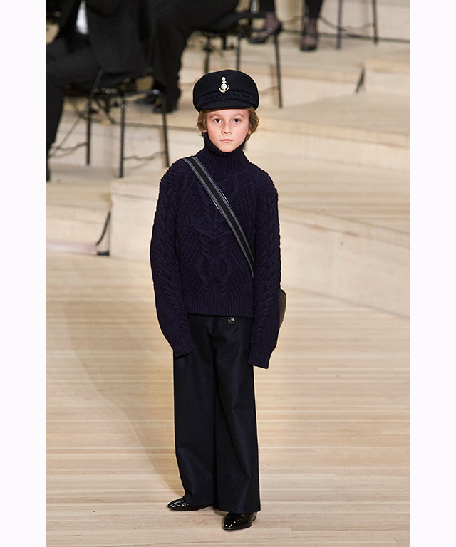 Nine year-old, Hudson Kroenig once again stole the show wearing head-to-toe navy with a '60s inspired sailor cap.