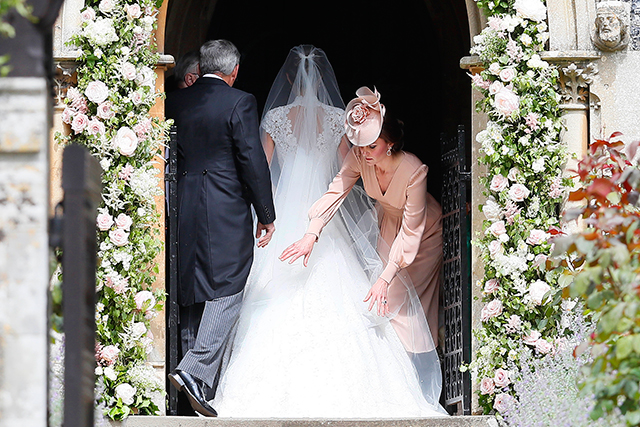 7.	Kate apparently took her bridesmaid duties very seriously, spending most of her time fussing over Pippa's train and taking care of the pageboys and flower girls. At one point she was seen silencing son George, which later led to tears from the young prince.