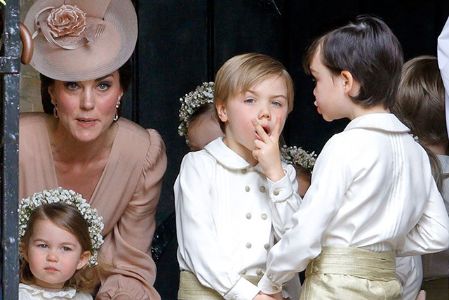 8.	Another pageboy was seen making a rude gesture to cameras, before Kate spotted him.