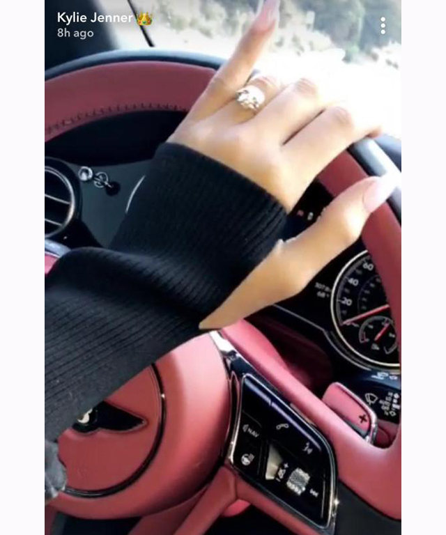 One of Kylie's most recent snapchats shows a very large rock on her left hand hinting that she and boyfriend (/potential baby daddy) Travis Scott are engaged.
