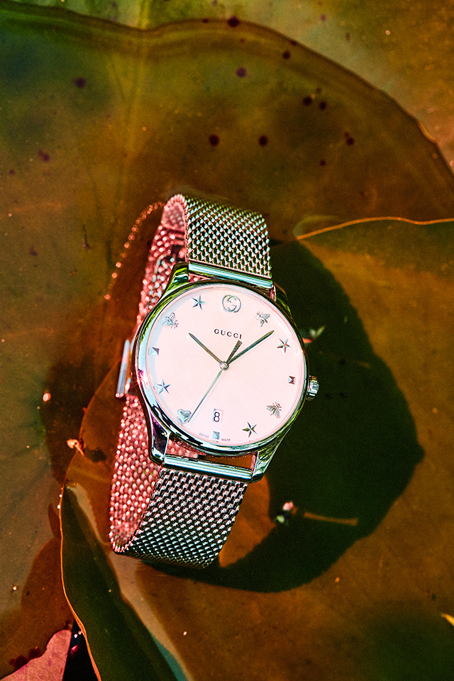 G-Timeless watch with steel case with white mother of pearl dial, steel mesh bracelet. $1,825