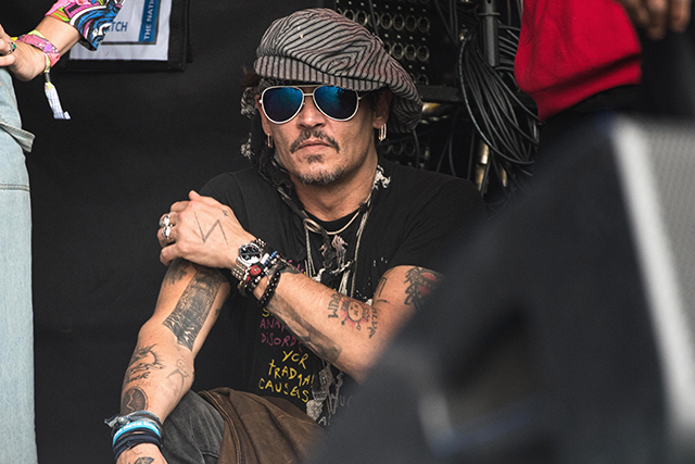 Johnny Depp watches the Run The Jewels set