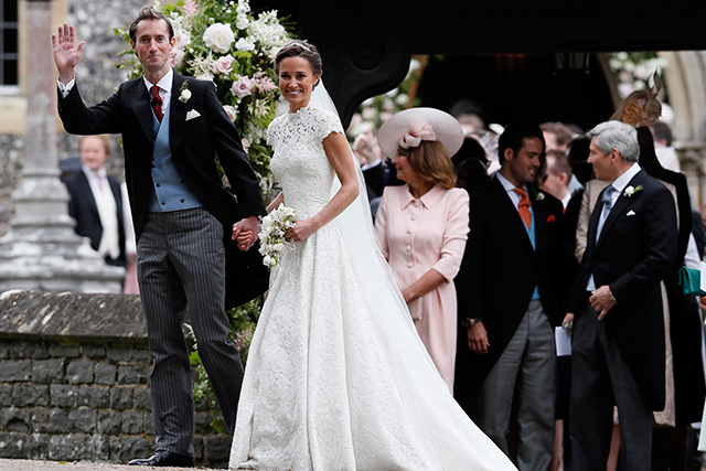 15.	Despite the couple's happy waves to cameras outside the church, the reception was a tightly secured affair. Guests had to hand over photographs and use a password to enter the reception.