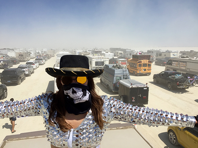 70,000 people trying to enter a festival is a logistical nightmare. We arrived on Sunday morning around 11am. We didn't get into Burning Man until 7pm. Here's me standing on the roof of the RV trying to scope out the line (don't try this at home).