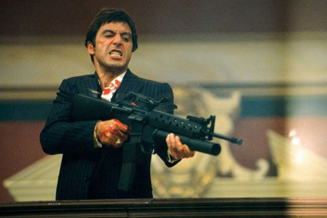 5. A framed poster of the film Scarface.