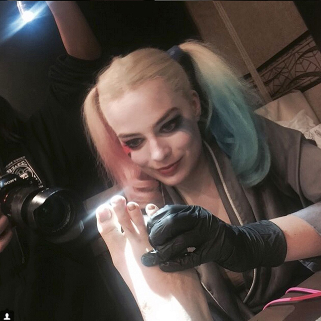 6. She tattooed Cara Delevingne's foot on the set of 'Suicide Squad'.