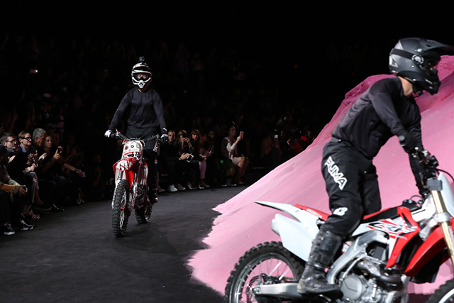 The bikes take to the pink sand dune runway at Fenty x Puma by Rihanna. Image: Getty